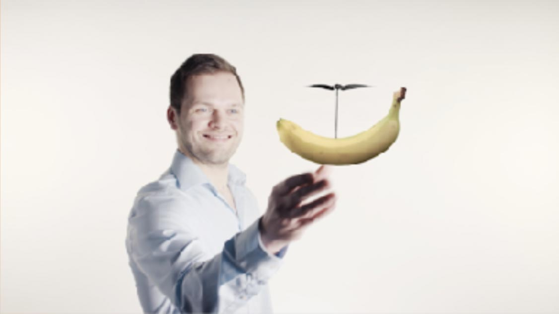 Orange Council - A laughing employee lets a banana hover using a helicopter rotor. Campaign theme for Bosch.