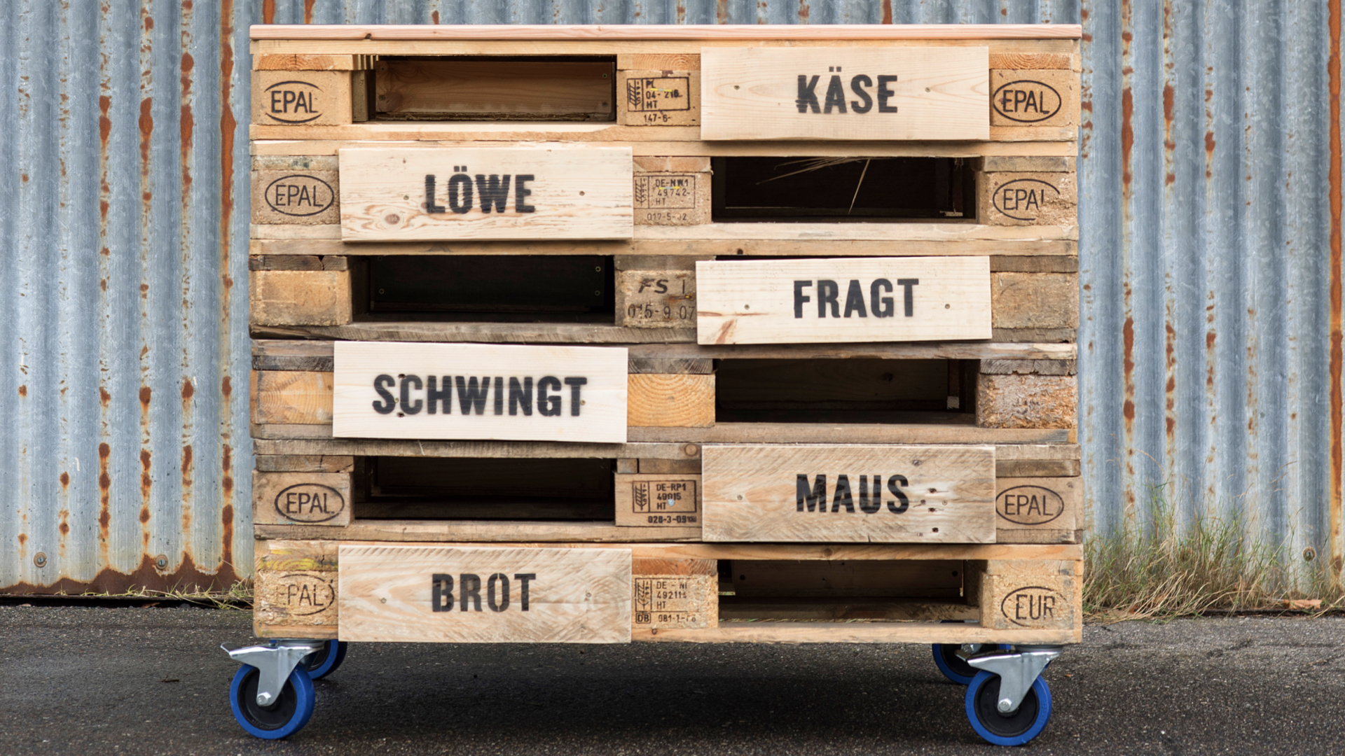 "Cabinet made from pallets, drawers with word pairs like ""bread"" and ""cheese"", were created in the Orange Council project Kiel Universe."